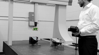 A Technician at Jesse Garant Metrology performing a laser scanning inspection of an industrial part